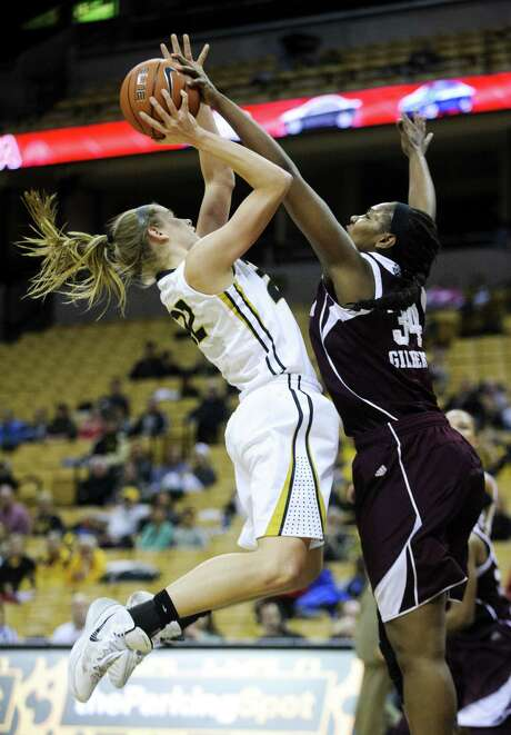 Texas A&M's Karla Gilbert, right, snuffs out a shot by Missouri's Jordan Frericks. Photo: Nick Schnelle, MBO / Columbia Daily Tribune