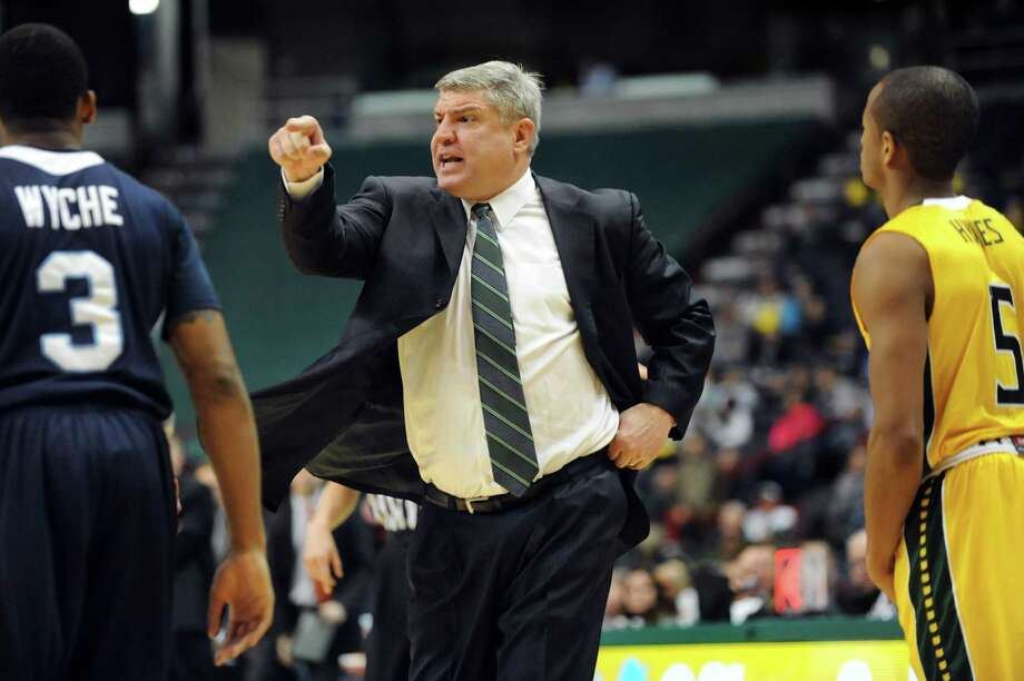 Siena's coach Jimmy Patsos, center, chews out his players during their basketball game against St. Peter's on Thursday, Jan. 23, 2014, at Times Union Center in Albany, N.Y. (Cindy Schultz / Times Union) Photo: Cindy Schultz / 00025450A