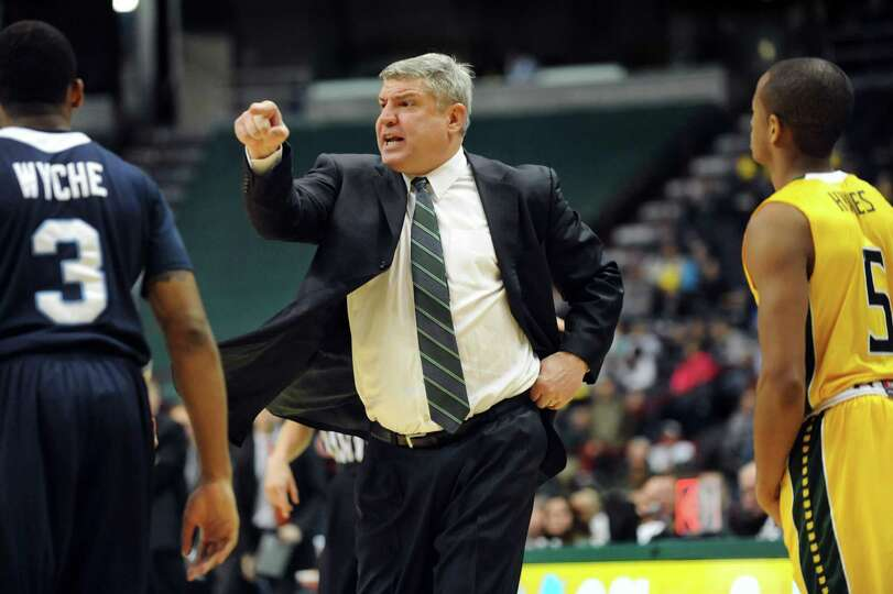 Siena's coach Jimmy Patsos, center, chews out his players during their basketball game against St. P