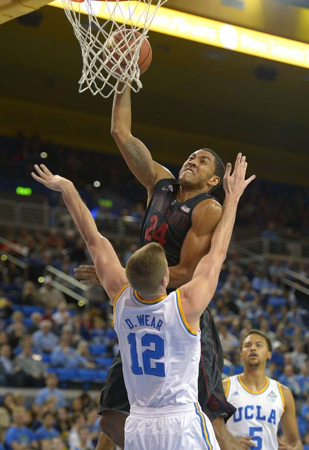 Stanford's Josh Huestis, who had 12 points and 12 rebounds, puts up a shot over UCLA's David Wear. Photo: Mark J. Terrill, Associated Press