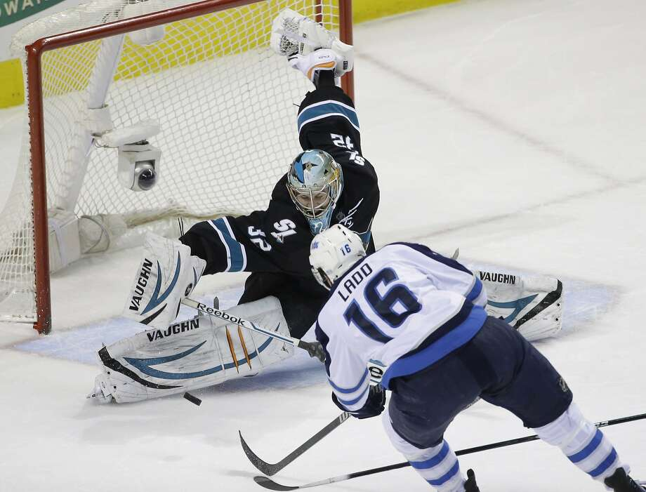 Sharks goaltender Alex Stalock stops a shot by Winnipeg's Andrew Ladd in the first period. Photo: Marcio Jose Sanchez, Associated Press