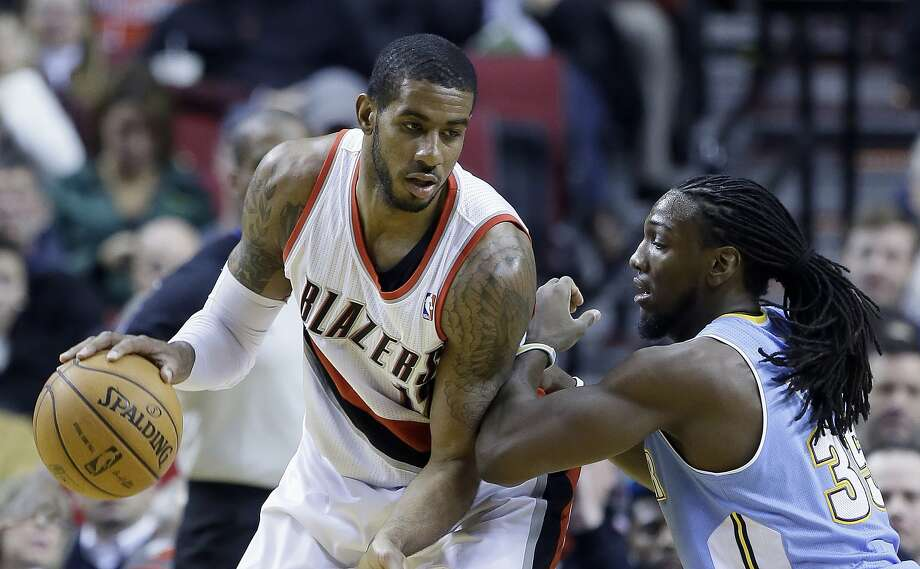 LaMarcus Aldridge (left), trying to work around Kenneth Faried, scored 44 points in Portland's win. Photo: Don Ryan, Associated Press
