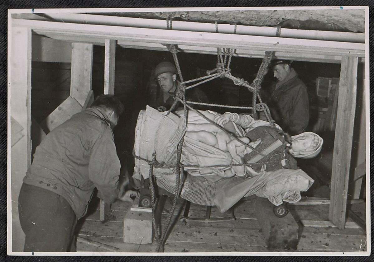 Stephen Kovalyak, George Stout and Thomas Carr Howe transporting Michelangelo's sculpture Madonna and child, 1945 July 9