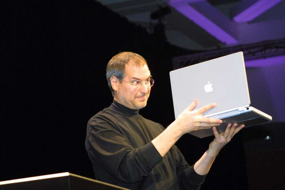 Steve Jobs introduces the Powerbook G4 on January 9, 2001. The device, marketed to professionals, was much smaller than Apple's early laptops. Photo: Alan Dejecacion, Getty Images