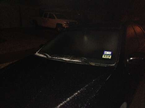 Ice covers cars in Cypress early Friday morning in Houston. Photo: Bryan Kirk, Houston Chronicle