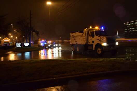 Ice covers roads across Houston early Friday morning as sand trucks work to make conditions safer. Photo: Cory Heikkila, Houston Chronicle