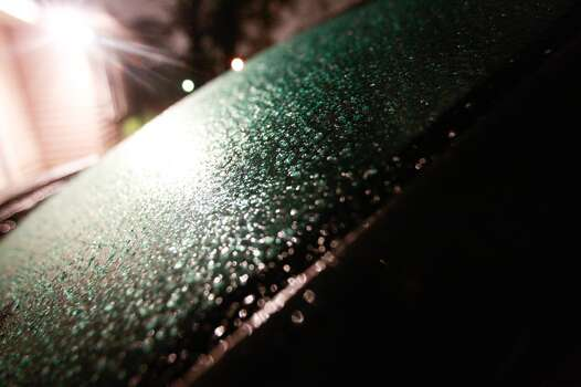Ice covers a car windshield early Friday morning in in Houston. Photo: Johnny Hanson, Houston Chronicle