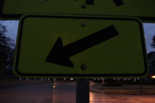 Ice covered a street sign in Northwest Houston early Friday morning. Photo: James Nielsen, Houston Chronicle
