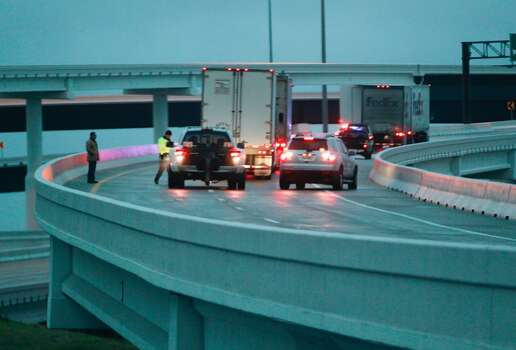 Ice prohibits vehicles from driving on an off ramp on Beltway 8 southbound onto Hwy. 290 early Friday morning. Photo: Johnny Hanson, Houston Chronicle