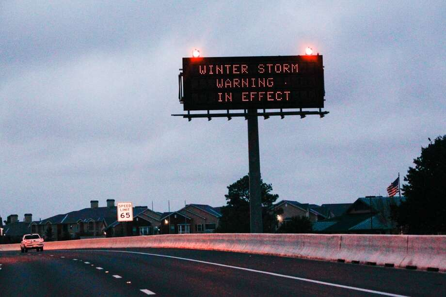 The sign on Beltway eight near 290 remind travelers about the weather. (Johnny Hanson / Houston Chronicle)  If you have photos of icy conditions in your area, send them to photos@chron.com. Photo: Johnny Hanson, Houston Chronicle