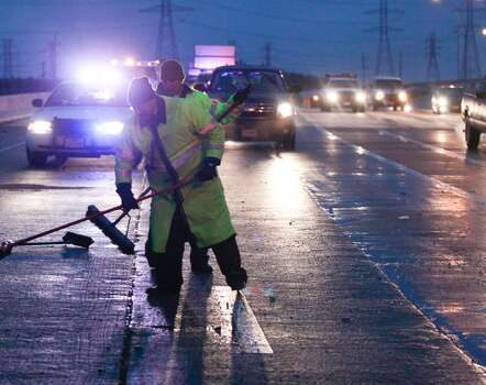 Crews cleanup an accident on Beltway eight near 249. (Johnny Hanson / Houston Chronicle) Photo: Johnny Hanson, Houston Chronicle