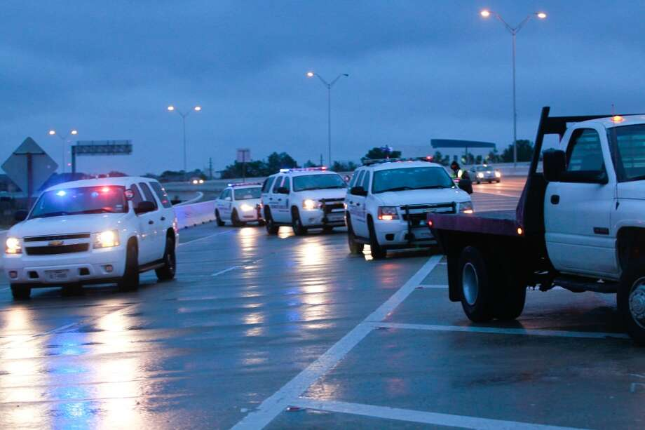 Police cars block the entrance ramp onto Hwy. 290 form Beltway 8 due to ice early Friday morning. Photo: Johnny Hanson, Houston Chronicle
