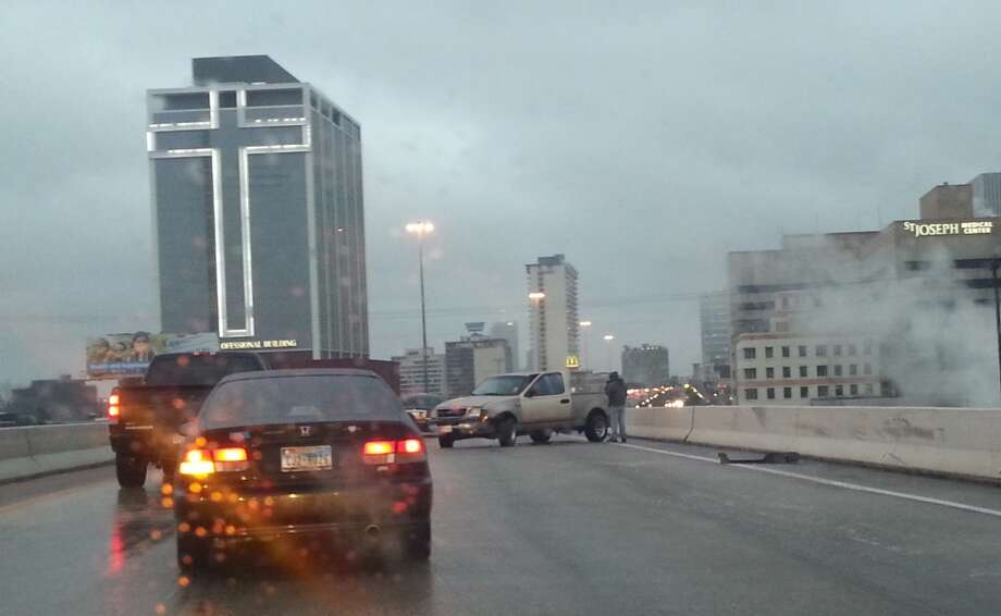 A single-vehicle accident on the Gulf Freeway northbound after the US 59 exit ramp (which happens to be closed). The vehicle apparently spun out on the ice that covers the roadway from before the 59 ramp through downtown. Photo: Dana Guthrie, Houston Chronicle