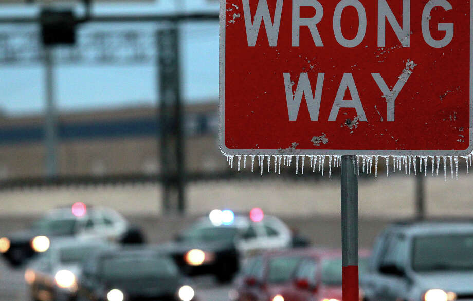 Icicles hang off a wrong way sign on IH-35 northbound as tarffic is diverted off the highway near Walzem road becuase of iced over bridges. Photo: JOHN DAVENPORT, SAN ANTONIO EXPRESS-NEWS / ©San Antonio Express-News/Photo may be sold to the public