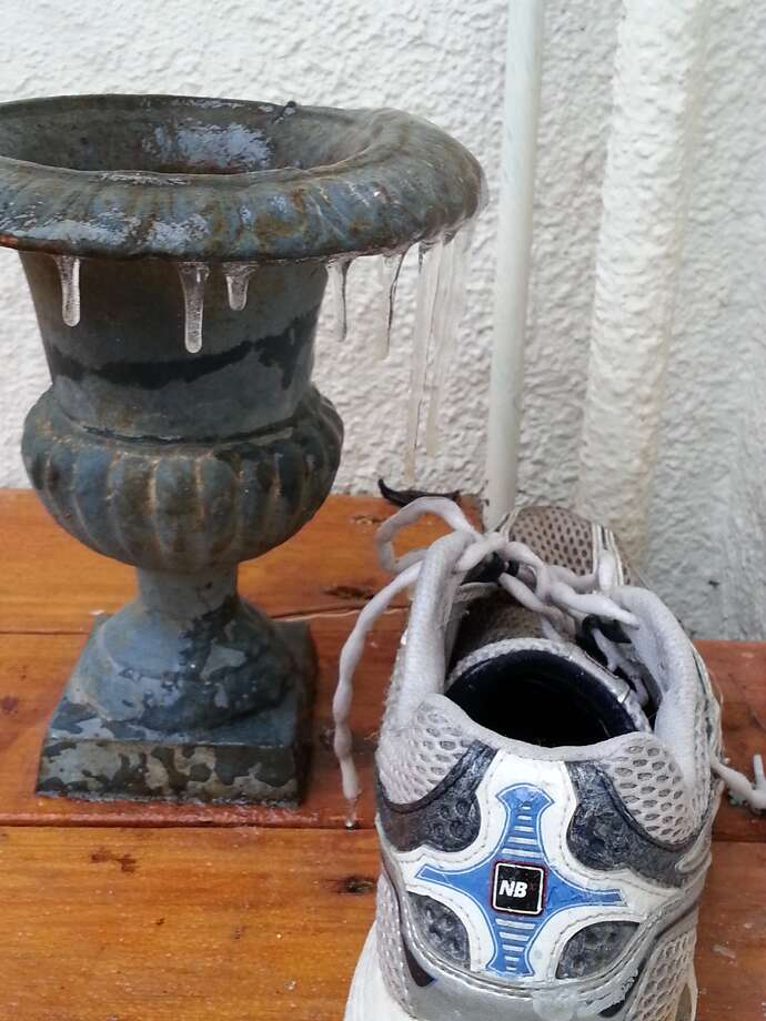 Icicles in Monte Vista and an icy sneaker. Photo: Emily Spicer/San Antonio Express-News