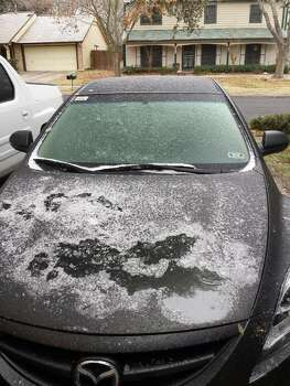 Ice is seen on a vehicle in the 14000 block of Falcon Hill, between Judson and Nacogdoches, just south of 1604 Friday, Jan. 24, 2014. Photo: Diana Fuentes/San Antonio Express-News