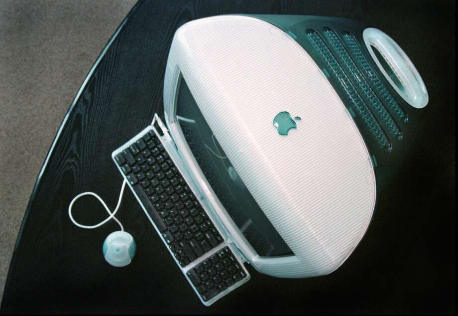 "An overhead view of the iMac in August 1998. This computer revolutionized the desktop, Bajarin said, and led to the moment in 2000 when Jobs told an audience the Mac would be the center of its ""digital lifestyle."" Photo: BEN MARGOT, AP Photo"