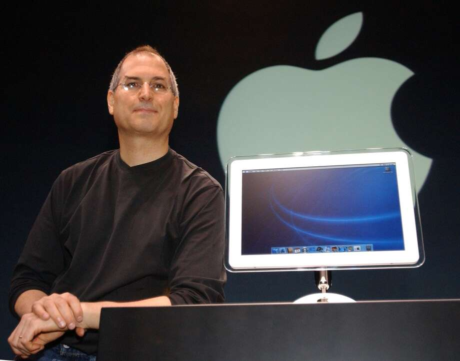 Steve Jobs talks about new software and hardware at Macworld Conference and Expo in New York on July 17, 2002.  An iMac with a new 17-inch LCD was introduced. Photo: CHIP EAST, REUTERS