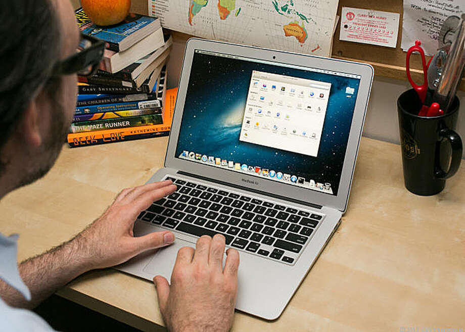 Released in June 2013, the new 13-inch MacBook Air has a fourth-generation Intel Core processor and up to 12 hours of battery life. Photo: Cnet Review / ONLINE_YES