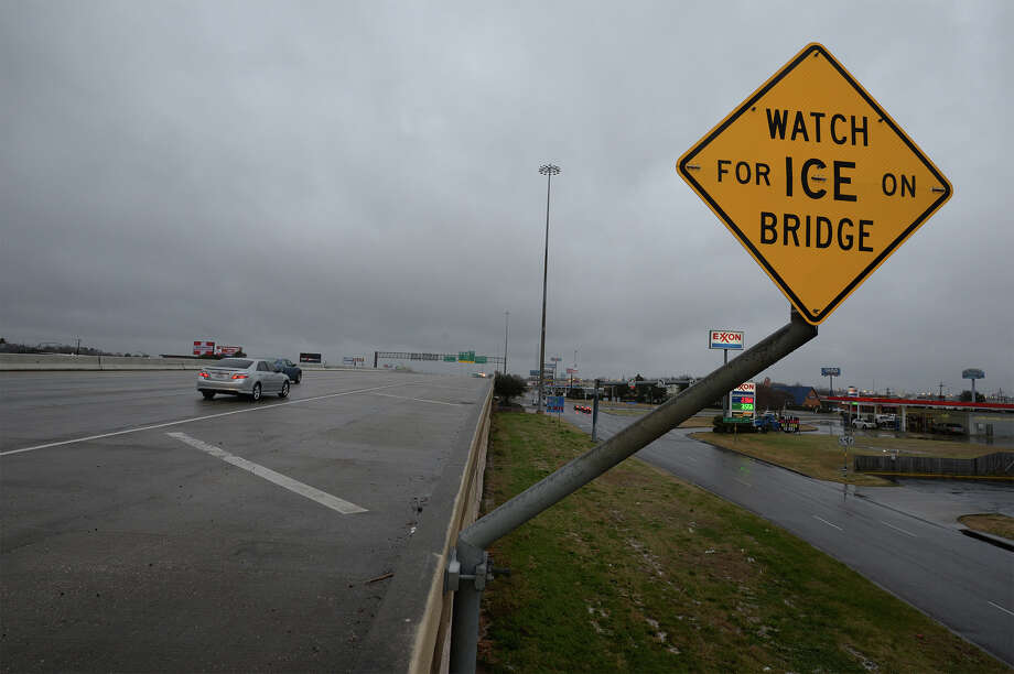 Interstate 10 is shut down due to icy roads. Commuters use feeder roads as a bypass. 