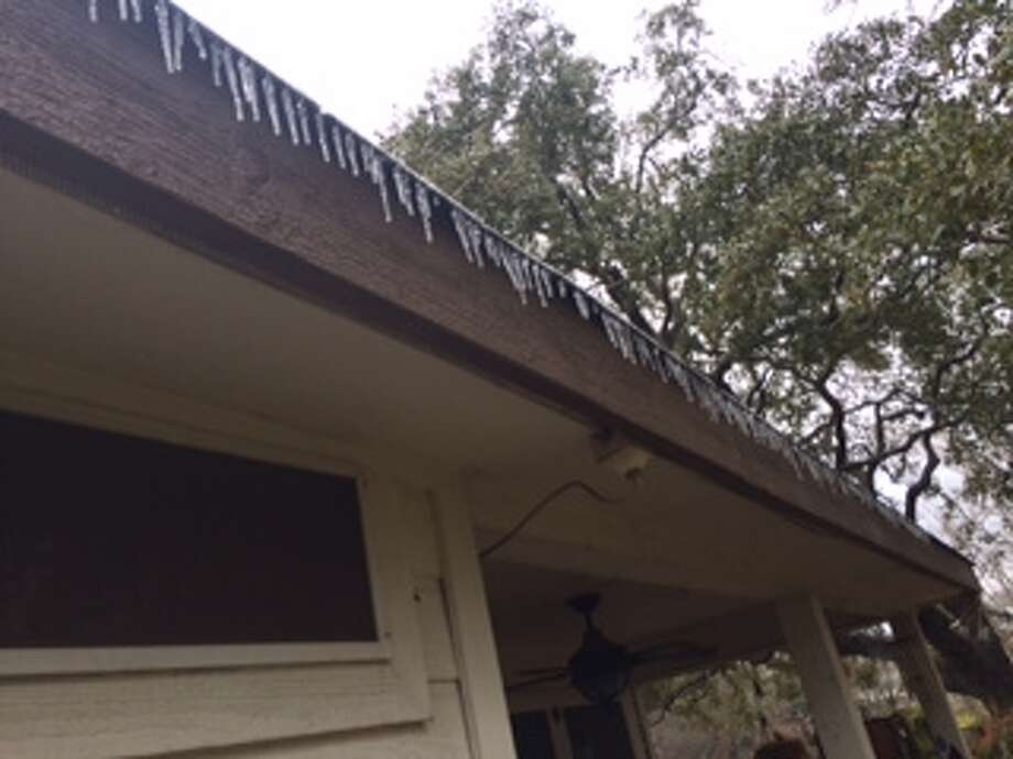 Icicicles adorn a house in Schertz Friday, Jan. 24, 2014. Photo: Vince Davis/San Antonio Express-News