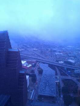 Downtown Houston is pictured from the Chase Tower. A winter storm hit Houston Friday, Jan. 24, 2014, causing problems around the city. (Craig Hlavaty / Houston Chronicle)