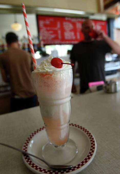 Eat an ice cream treat at the St. Francis Fountain, open since 1918 on lower 24th Street in the Mission District. Photo: Liz Hafalia, The Chronicle / SFC