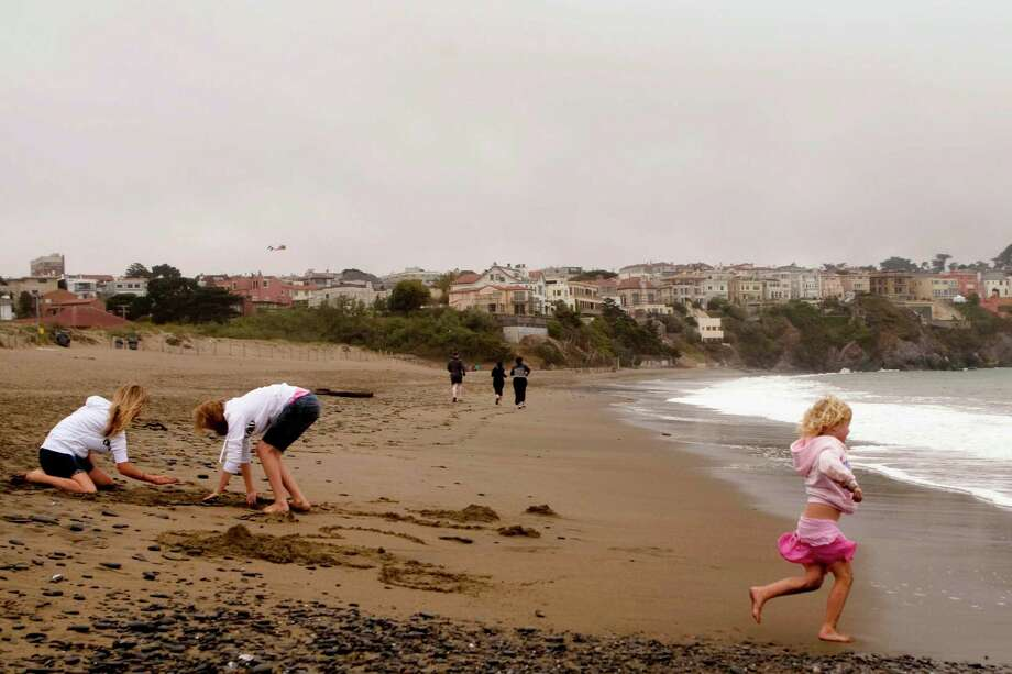 Build a sandcastle at Baker Beach. Photo: Stephen Lam, The Chronicle