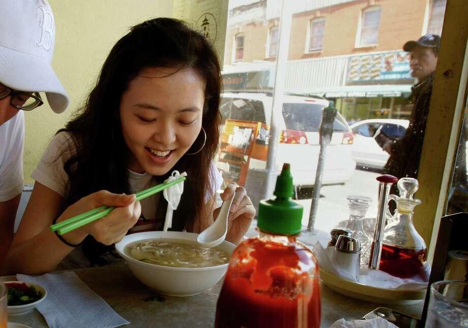 Slurp up a bowl of pho (Vietnamese noodle soup) at Turtle Tower in the Tenderloin. Photo: Liz Hafalia, The Chronicle / SFC