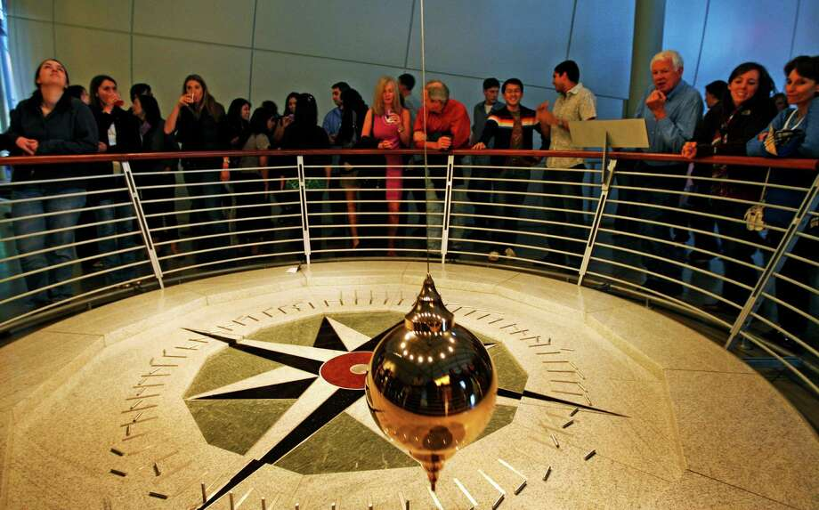 Gaze at the Foucault Pendulum until it knocks over a pin at the Academy of Sciences. (Don't miss a show at the Morrison Planetarium.) Photo: Lance Iversen, The Chronicle