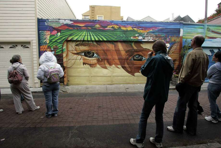 Take a walk down the Mission District's Balmy Alley and Clarion Street, the most concentrated collections of murals in the city. Photo: Liz Hafalia, SFC / San Francisco Chronicle