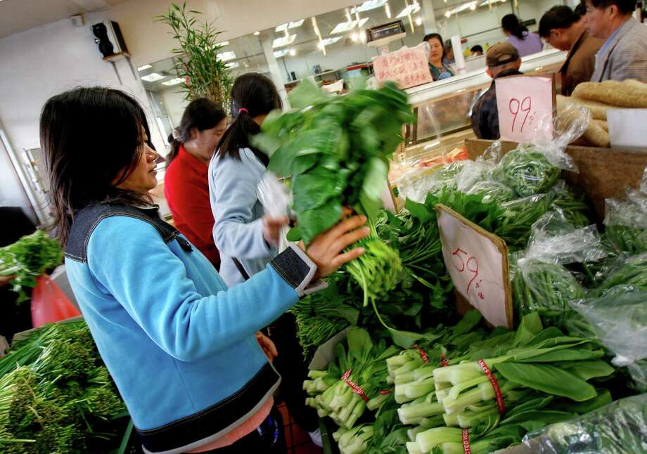 Shop for vegetables in Chinatown and use them to make a stir-fry at home. Photo: Brant Ward, The Chronicle