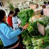 Shop for vegetables in Chinatown and use them to make a stir-fry at home.
