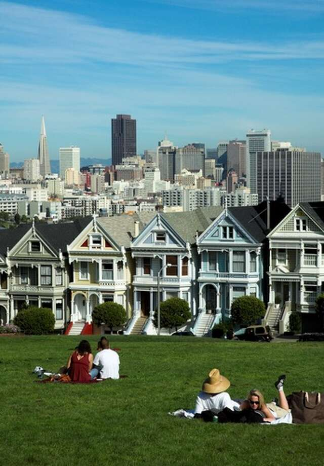 Walk by the Painted Ladies, a row of elaborately painted Victorians facing Alamo Square Park on Steiner Street. Afterward, play in the park. Photo: Shutterstock, Can Balcioglu