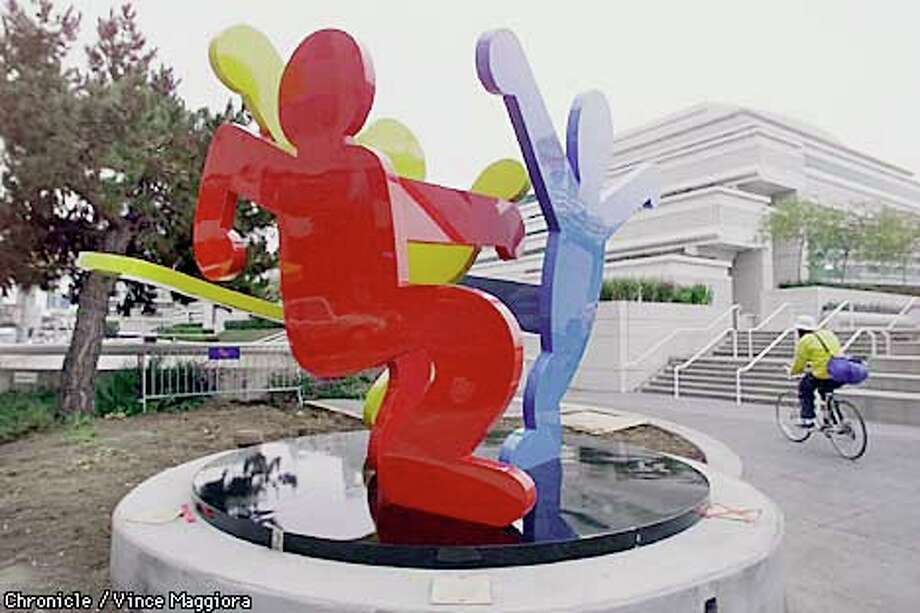 "Pay your respects to artist Keith Haring's ""Three Dancing Figures""–an abstract sculpture featuring brightly colored figures with their arms and legs intertwined–at Moscone Center between Howard and Third. Photo: SFC"