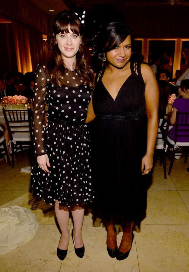 Actresses Zooey Deschanel (L) and Mindy Kaling attend ELLE's Annual Women in Television Celebration on January 22, 2014 in West Hollywood, California. Photo: Michael Buckner, Getty Images For Elle