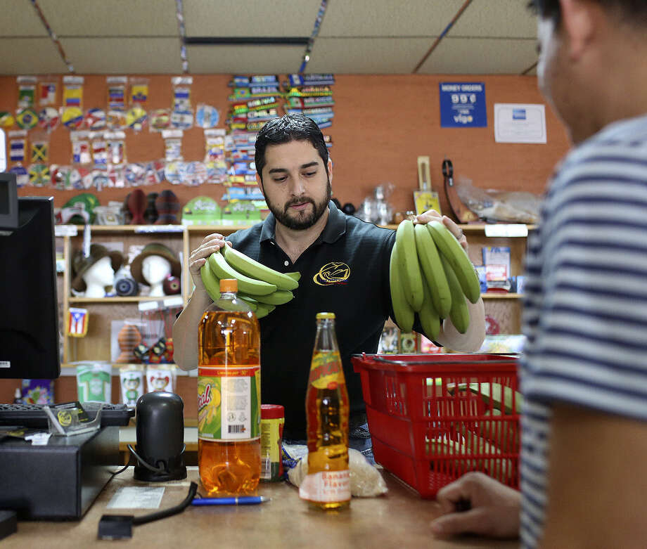 David Jaramillo handles the checkout at Las Americas Latin Market. / San Antonio Express-News