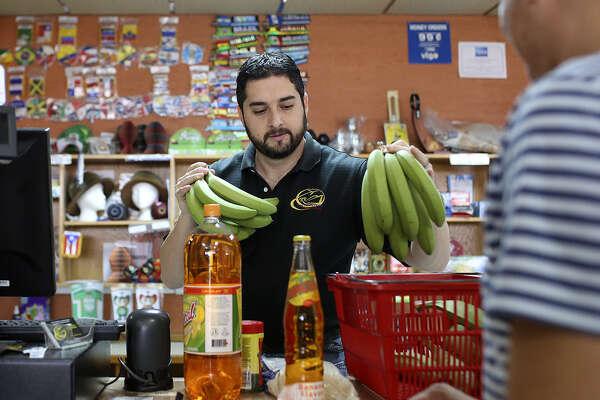 David Jaramillo handles the checkout at Las Americas Latin Market.