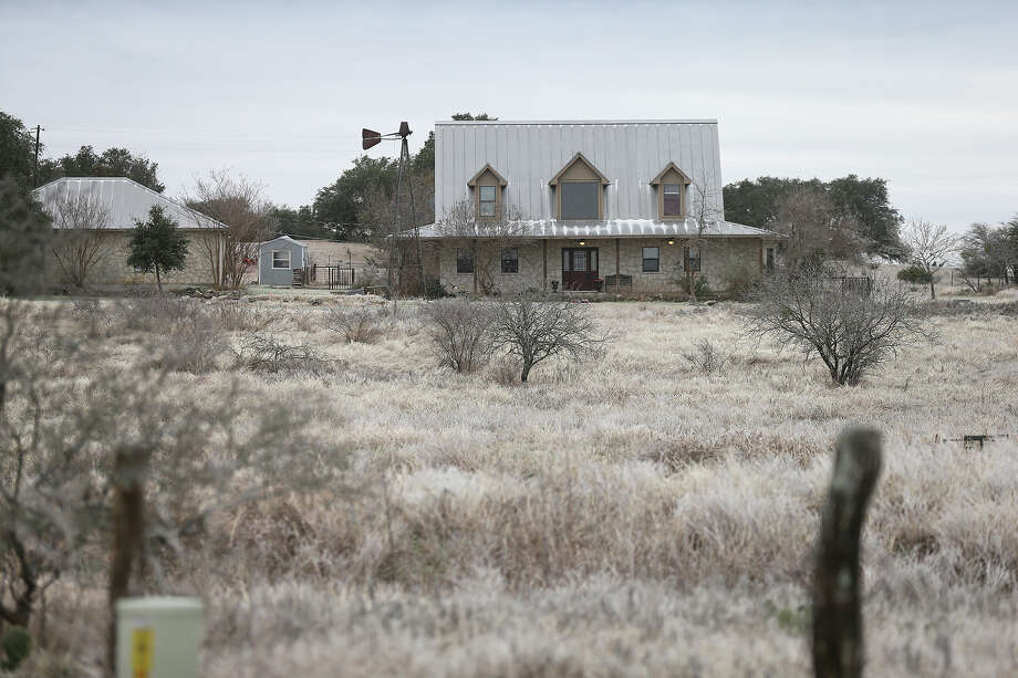 A home is nestled into frozen pastures as ice covers the countryside north of New Braunfels on January 24, 2014. Photo: Tom Reel, San Antonio Express-News