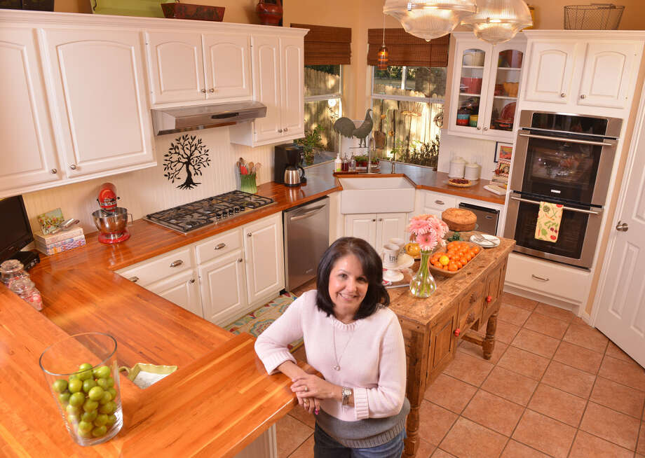 Ina Kenyon Elledge loves to bake, and her husband likes to grill. She designed her new kitchen, and her husband built it. Photo: Photos By Robin Jerstad / For The Express-News