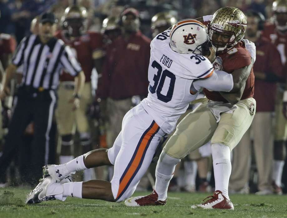 """South teamDee Ford, DE, Auburn 6'2"""" 240 pounds 22 years old Ford's final season at Auburn was productive - with 29 tackles, 14.5 TFL and 10.5 sacks. He was named first team All-SEC. Photo: David J. Phillip, Associated Press"""