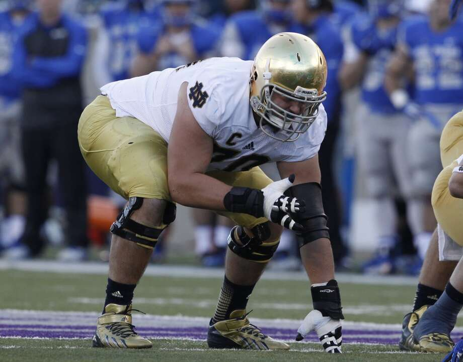 """North teamZack Martin, OT, Notre Dame 6'4"""" 308 pounds 23 years old Martin started all 52 games of his Irish career and was named the 2013 New Era Pinstripe Bowl Most Valuable Player - the first offensive lineman to win a bowl MVP outright since 1959. Photo: David Zalubowski, Associated Press"""