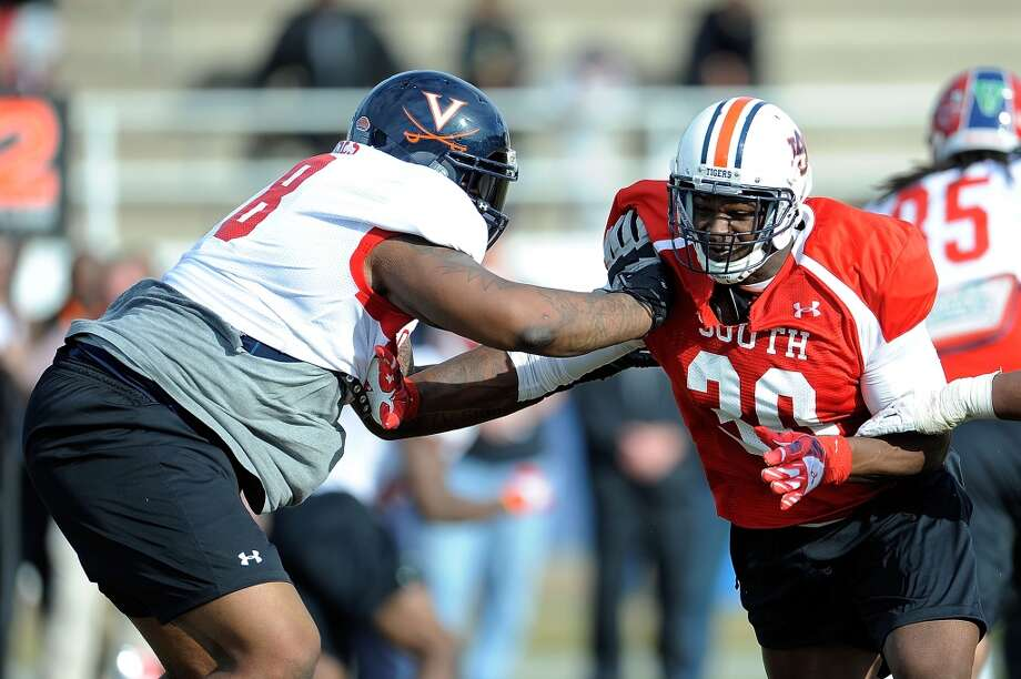"""South teamMorgan Moses, OT, Virginia 6'6"""" 335 pounds 22 years old Moses was named to the preseason All-ACC list, the Outland Trophy Watch List and the Lombardi Award Watch List prior to his Senior season. Photo: Stacy Revere, Getty Images"""