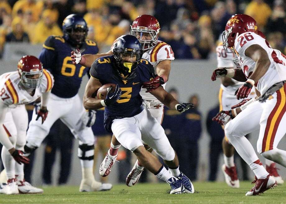 "North team Charles Sims, RB, West Virginia 6'0"" 213 pounds 23 years old The Houston native transferred from UH to West Virginia for his final year of eligibility and was named the 2013 Big 12 Conference Newcomer of the Year. Photo: Christopher Jackson, Associated Press"
