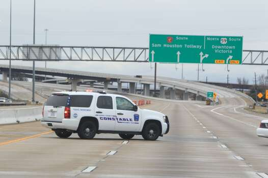 Sam Houston Tollway southbound is pictured closed by Harris County Constable Precinct 5 due to ice on Jan. 24, 2014.  (Mayra Beltran / Houston Chronicle)