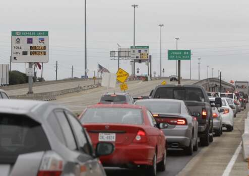 Traffic moves slowly off 290 near Jones Rd. as vehicles are being diverted onto the feeder to avoid overpasses Friday, Jan. 24, 2014, in Houston. The HOV lanes are also closed. ( Melissa Phillip / Houston Chronicle ) Photo: Melissa Phillip, Houston Chronicle
