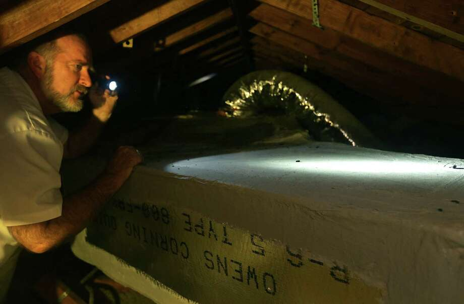 Don Baker of Mister-B Termite & Pest Control finds rat droppings on duct work in an attic in a home on the North Side. Photo: Photos By Bob Owen / San Antonio Express-News / © 2012 San Antonio Express-News