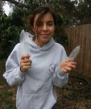 Maria Matticola holds ice that froze over leaves.