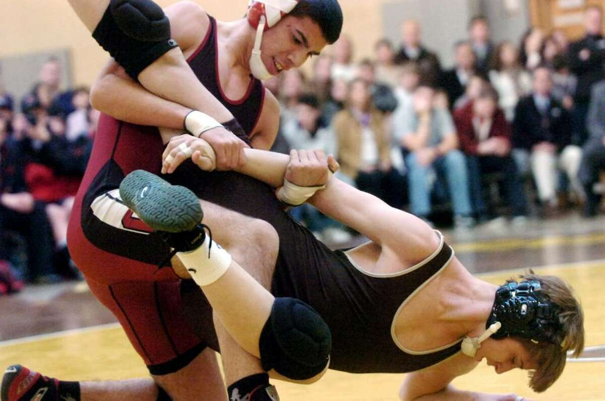 Greenwich's David Laborda wrestles Brunswick's Costas Hadjipateras to win the 140 pound division as Brunswick School hosts Greenwich High in a crosstown wrestling match. Greenwich High won the match 47-21.