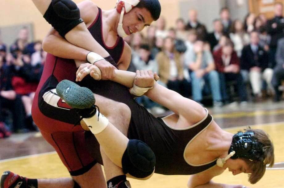 Greenwich's David Laborda wrestles Brunswick's Costas Hadjipateras to win the 140 pound division as Brunswick School hosts Greenwich High in a crosstown wrestling match. Greenwich High won the match 47-21. Photo: Keelin Daly / Greenwich Time